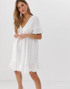 Read more about Asos design v front v back smock mini dress with pep hem in broderie