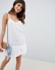 Read more about Asos design broderie bubble hem mini dress - white
