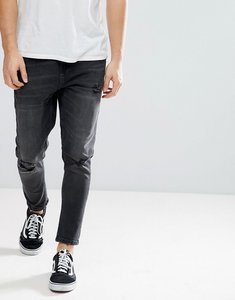 Read more about Bershka skinny tapered jeans in washed black - black