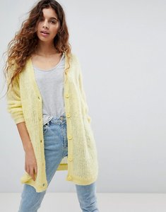 Read more about Asos cardigan in fluffy open knit - yellow