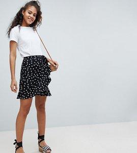 Read more about Asos design tall mini wrap skirt in polka dot print - mono