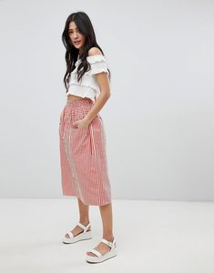 Read more about Asos design cotton midi skirt with button front in stripe - red ivory