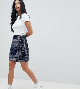 Read more about Glamorous petite mini skirt in bandana print with tie detail - navy