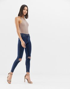 Read more about Asos design ridley high waist skinny jeans in deep blue wash with busted knees - mid wash blue