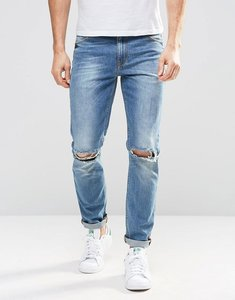 Read more about Asos skinny jeans in mid wash with knee rips - mid wash blue