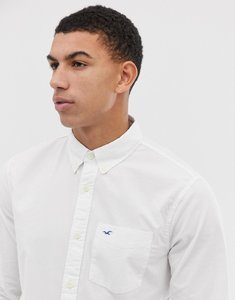 Read more about Hollister poplin icon seagull logo button down collar stretch slim fit pocket shirt in white - white