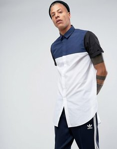 Read more about Asos regular fit super longline cut and sew shirt with black and navy panels - white