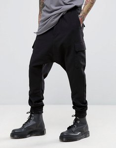 Read more about Bershka drop crotch cargo joggers in black - black