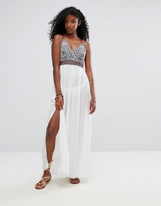 Read more about Liquorish heavy embroidered maxi beach dress with metail ring detail back - white multi