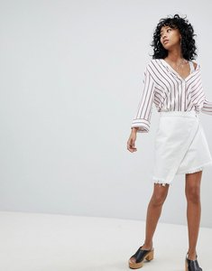 Read more about One teaspoon festival wrap mini skirt with frayed edge - white