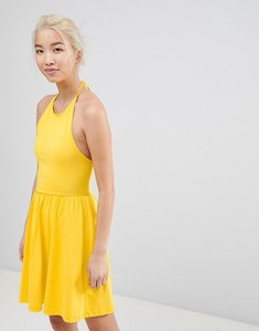 Read more about Asos mini smock sundress with lace up back - yellow