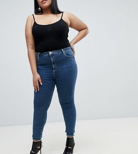 Read more about Asos curve ridley high waist skinny jeans in dena mid blue wash - mid wash blue