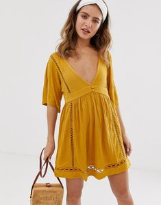 Read more about Asos design slubby mini dress with ladder trims