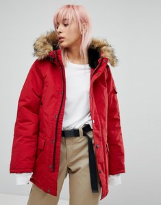Read more about Carhartt wip oversized anchorage parka jacket with faux fur hood - blast red black