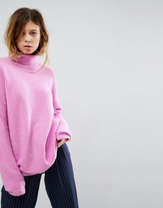 Read more about Asos jumper in fluffy yarn and roll neck - pale pink