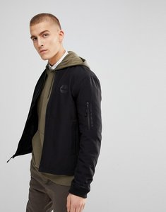 Read more about Timberland soft shell bomber jacket back logo in black - black
