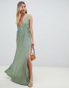 Read more about Asos design gathered waist crinkle high low hem beach dress - khaki