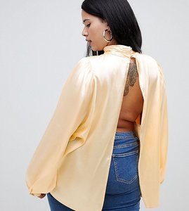 Read more about Asos design curve satin blouse with high neck and open back - buttermilk
