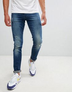 Read more about Armani exchange j14 skinny fit 5 pocket stretch jeans with abrasions in mid wash - blue