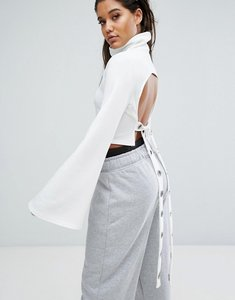 Read more about Missguided londunn eyelet detail open back high neck top - white