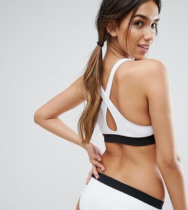 Read more about Monki plunge cross back bikini top with contrast band - white