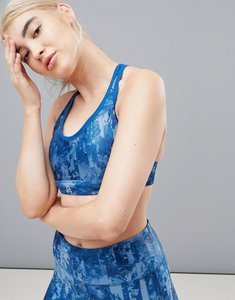 Read more about Reebok blue printed running bra - multi