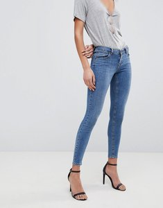 Read more about Asos design whitby low rise skinny jeans in dark wash blue - mid wash blue