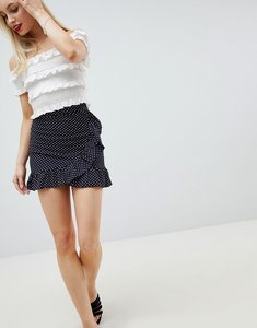 Read more about Lasula polka dot frill wrap skirt - navy