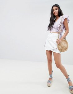Read more about Glamorous mini skirt with raw hem and distressing in denim - white