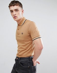 Read more about Fred perry reissues twin tipped polo in camel - d94