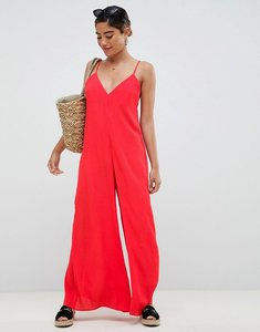Read more about Asos design deep v strap back jumpsuit - red