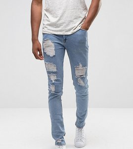 Read more about Asos tall skinny jeans in light wash blue vintage with heavy rips and repair - light wash vintage