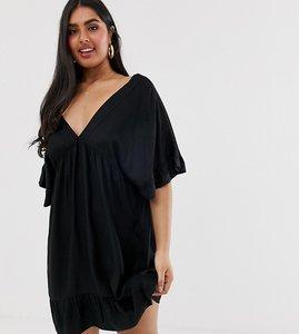 Read more about Asos design curve v front v back smock mini dress with pep hem