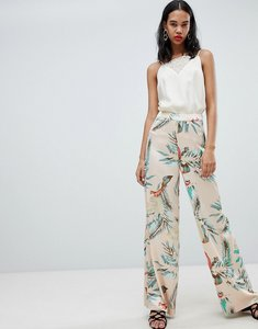 Read more about Missguided satin tropical print wide leg trousers - nude