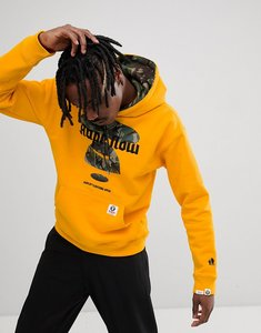 Read more about Aape by a bathing ape oversized hoodie with large camo logo - yellow