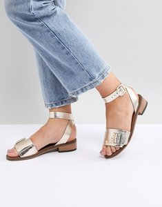 Read more about H by hudson leather flat sandals - gold