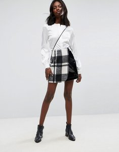 Read more about Asos check and vinyl mini skirt - black white