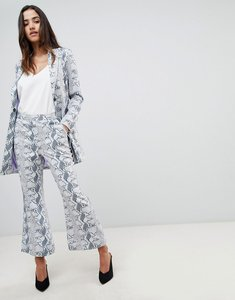 Read more about Unique 21 cropped flare trouser in snake print co-ord