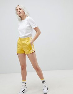 Read more about Adidas originals adicolor three stripe shorts in yellow - yellow