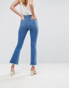 Read more about Asos design egerton rigid cropped flare jeans in mid wash blue with raw hem - mid wash blue