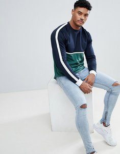 Read more about Asos design relaxed longline long sleeve t-shirt with contrast yoke in woven fabric and curve hem -