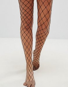 Read more about Asos oversized fishnet tights - black