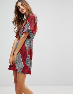Read more about Rock religion check frill dress - red grey