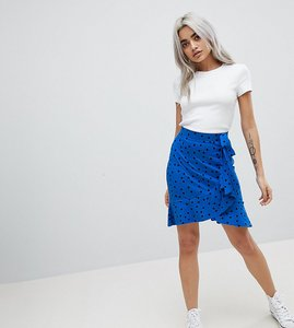 Read more about Asos petite mini wrap skirt in polka dot print - blue black
