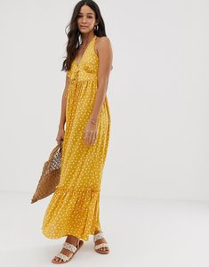 Read more about Asos design halter maxi dress with lace up in spot print