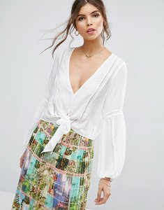 Read more about Asos plunge blouse with tie front and lace inserts - ivory