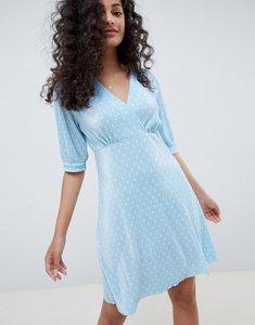Read more about Asos design polka dot plisse mini tea dress - baby blue
