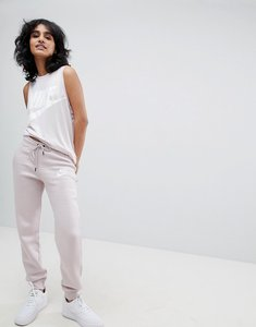 Read more about Nike rally slim fit sweatpants in pink - particle rose partic
