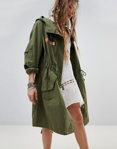 Read more about Native rose oversized parka jacket with tapestry tassel back panel - green