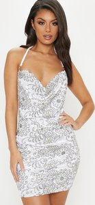 aa7405878b9b Read more about White embroidered sequin chain choker bodycon dress white